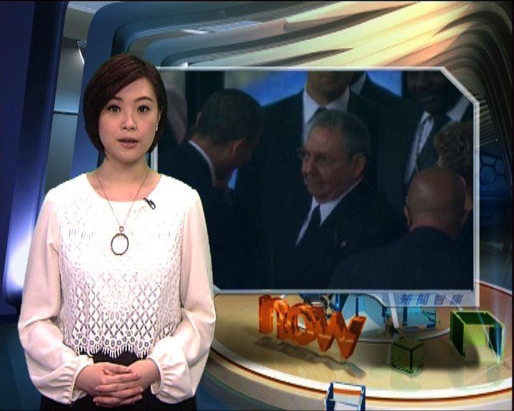 新聞智庫:奧巴馬勞爾握手惹爭議