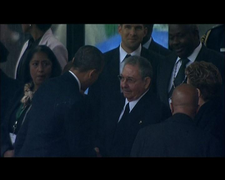 美國古巴領導人世紀握手惹爭議