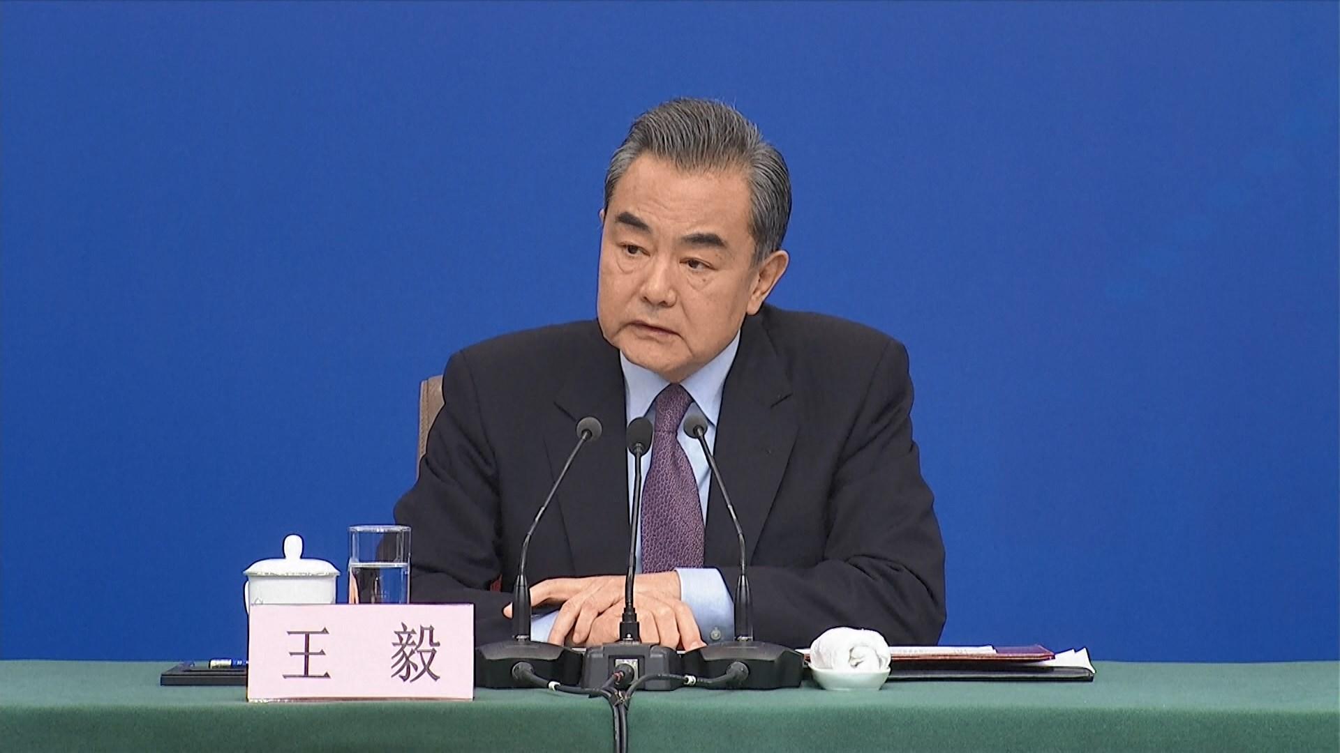 王毅:支持企業拿起法律武器維護自身權益