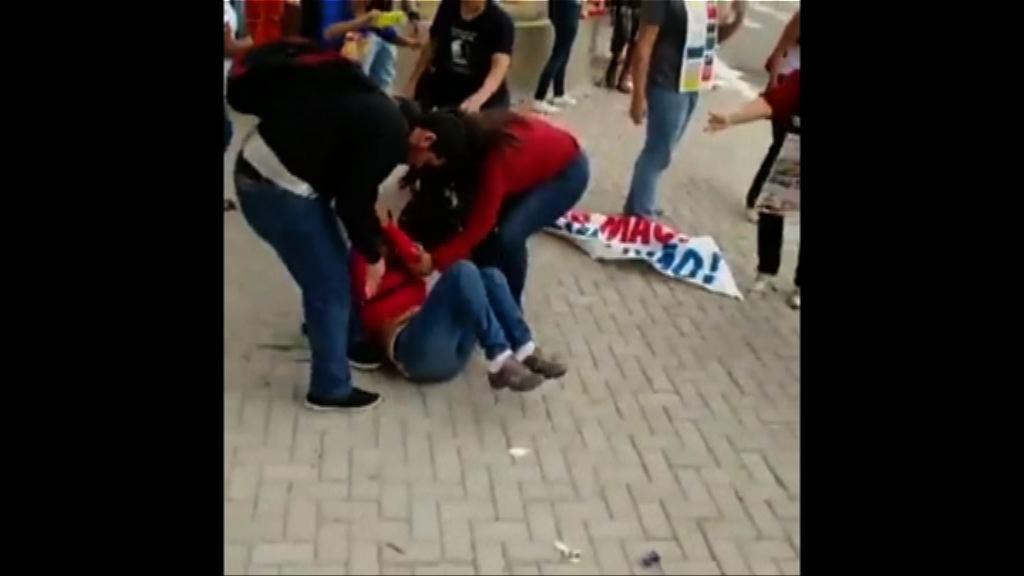 巴西民眾在奧運聖火傳遞路線示威