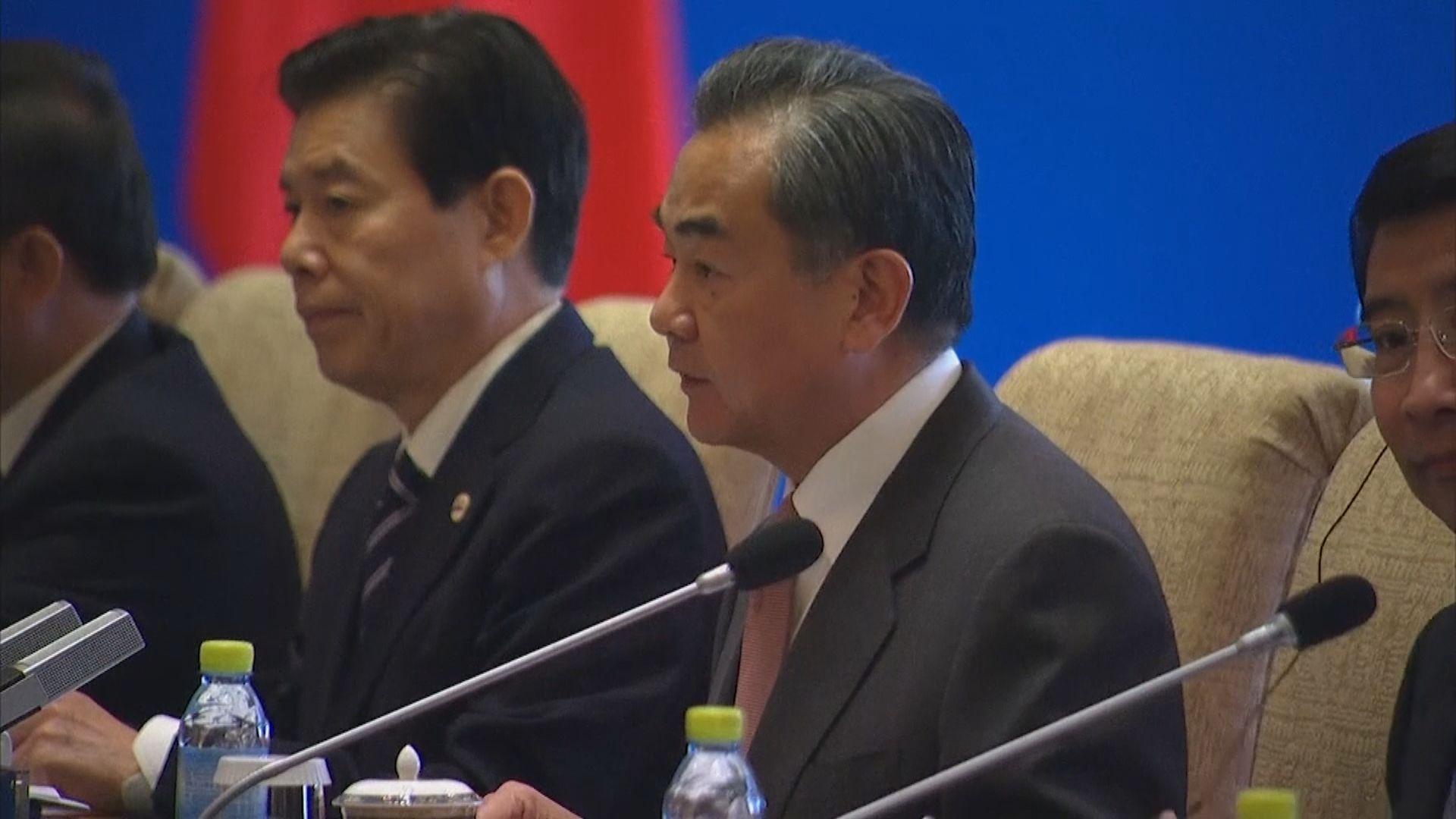 王毅:中日要為全球經濟和平穩定發展作貢獻