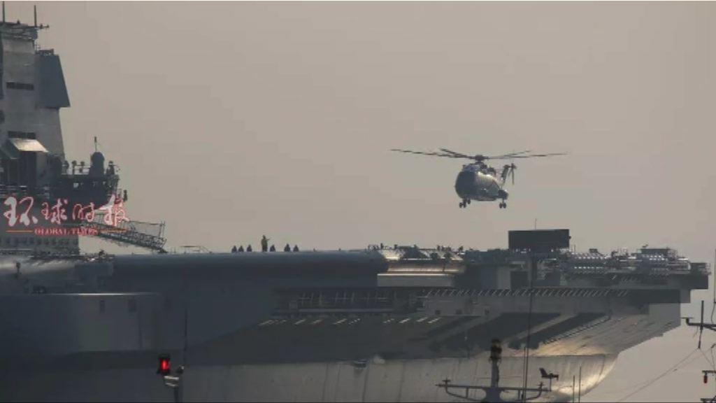 國產航母首有直升機升降料海試近