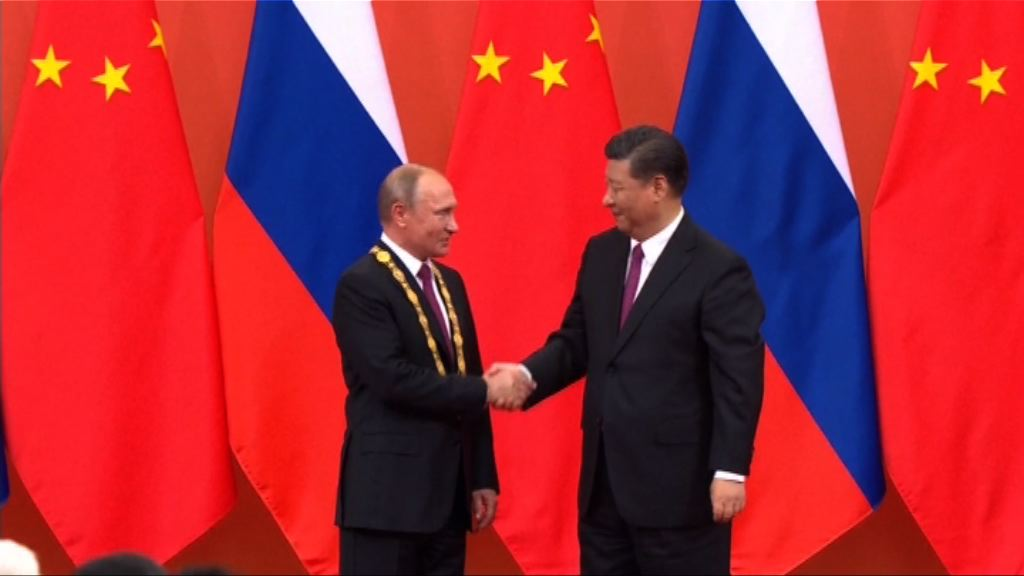 習近平向普京頒予中國友誼勳章