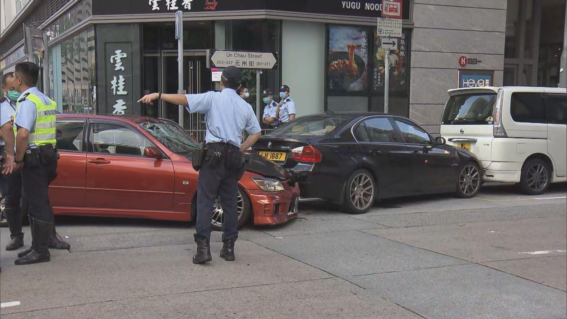 長沙灣一輛私家車衝路障一男一女被捕