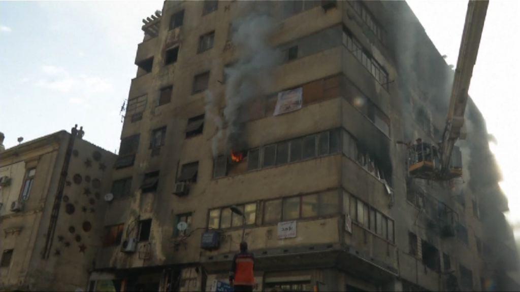 開羅一幢酒店起火數十人送院