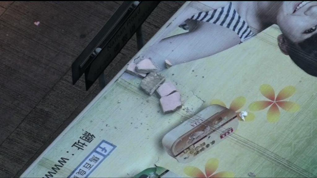 油麻地彌敦大廈外牆石屎剝落毀兩車