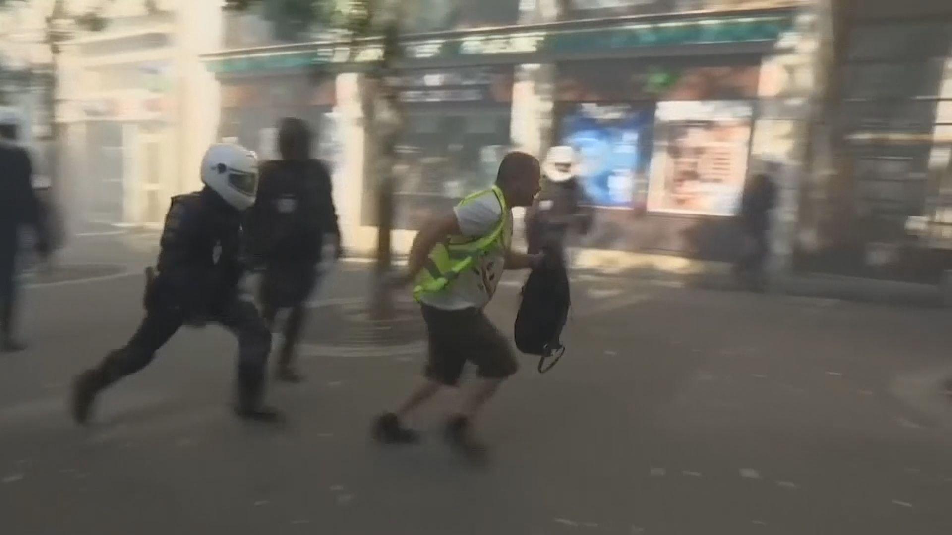 法國黃背心示威百多人被捕