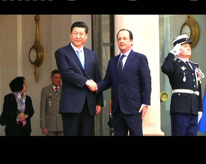 習近平在巴黎與奧朗德會面