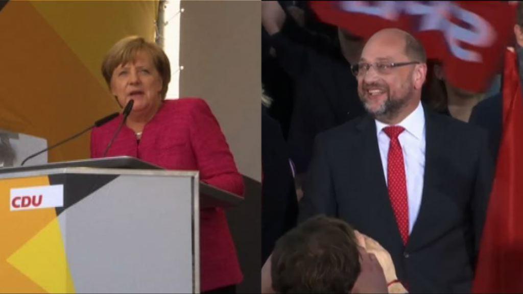 默克爾舒爾茨促選民投票捍衛民主