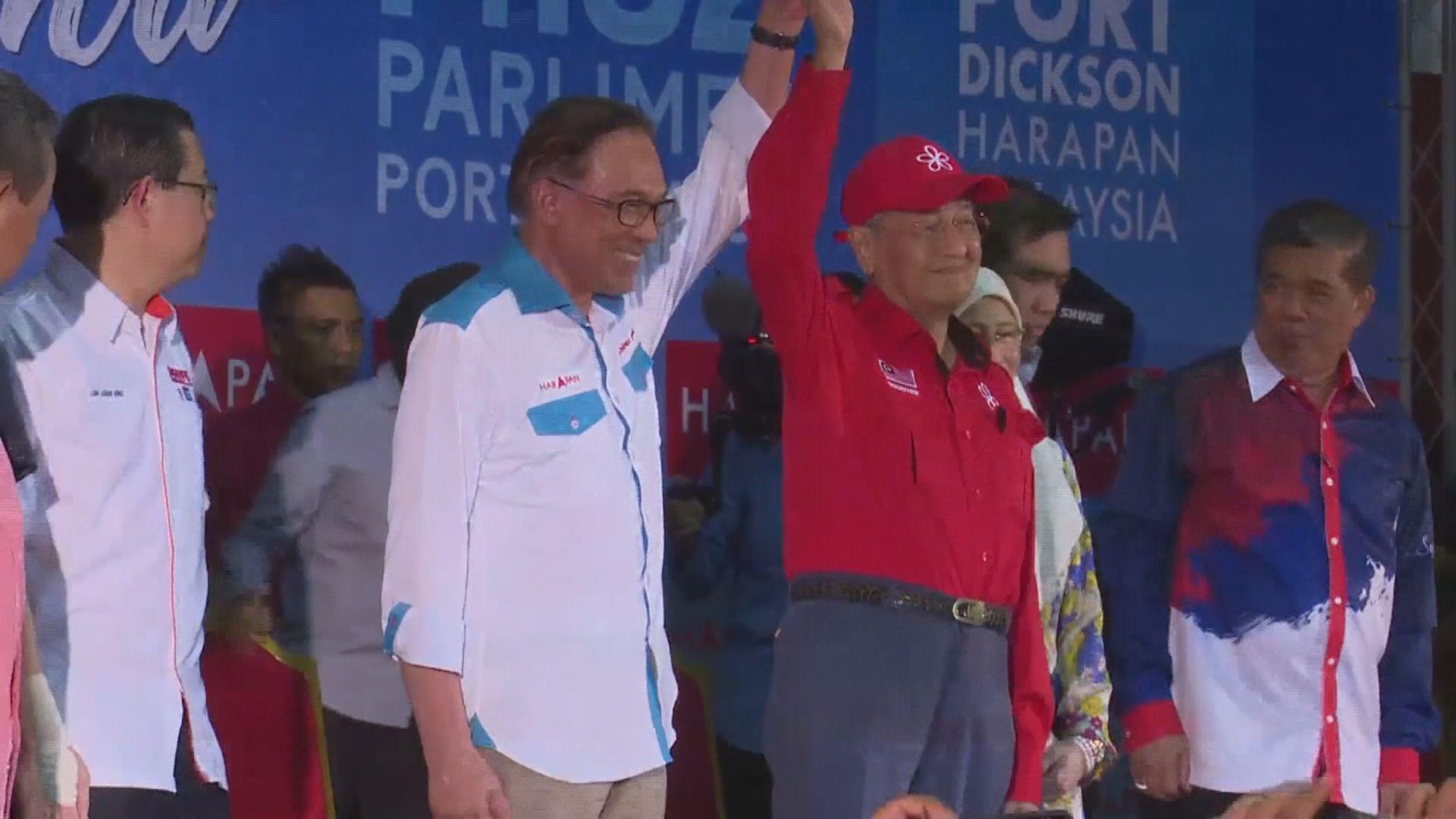 安華勝出馬來西亞國會補選重返政壇