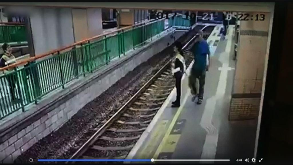 港鐵表示關注女工被推落路軌事件