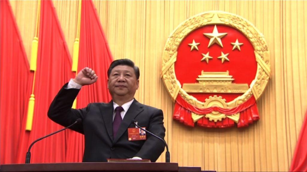 全票連任國家主席習近平在人民大會堂宣誓