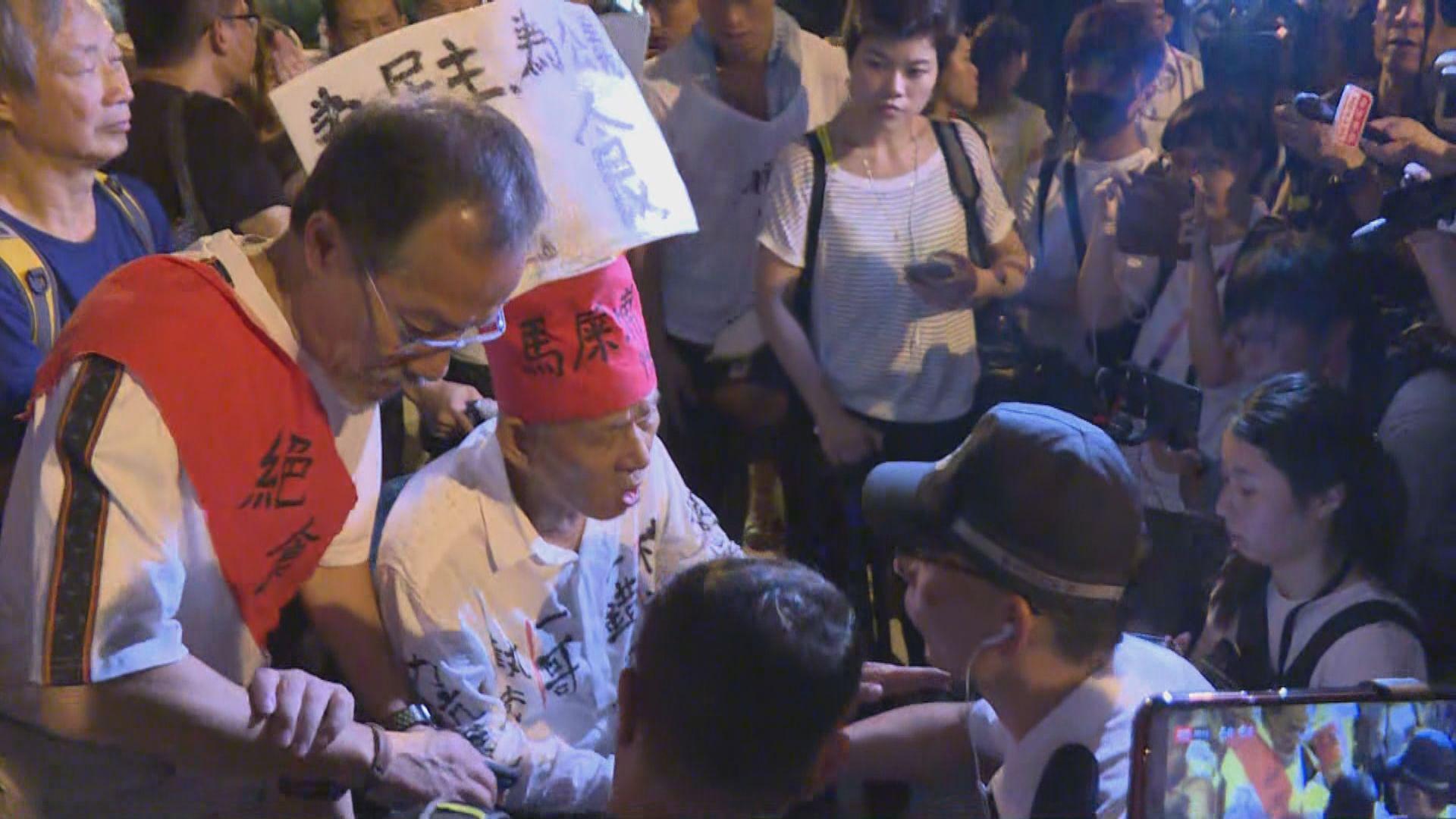 反修例絕食人士遊行 要求到禮賓府正門示威