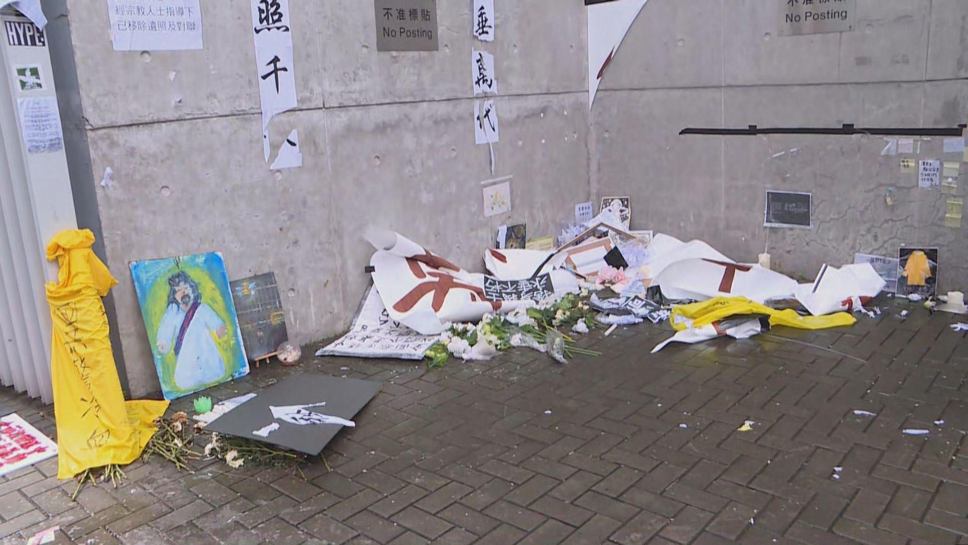 有撐警集會人士將政總外牆反修例標語撕下