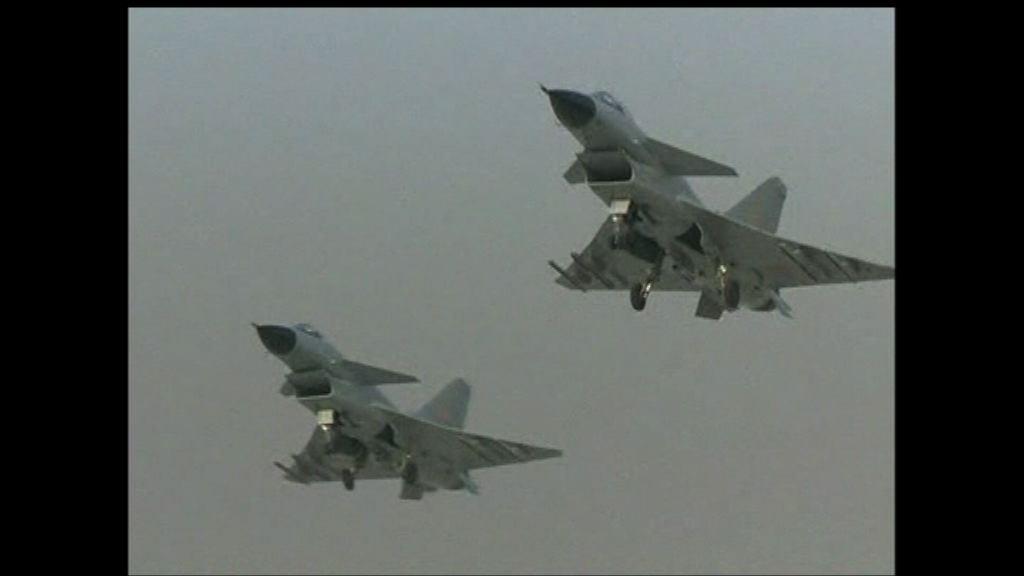 美軍指偵察機遭解放軍戰機攔截