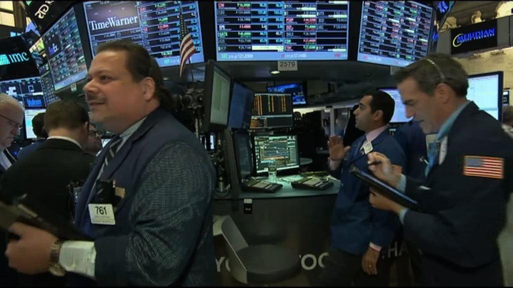 金融股急升 道指重上二萬關