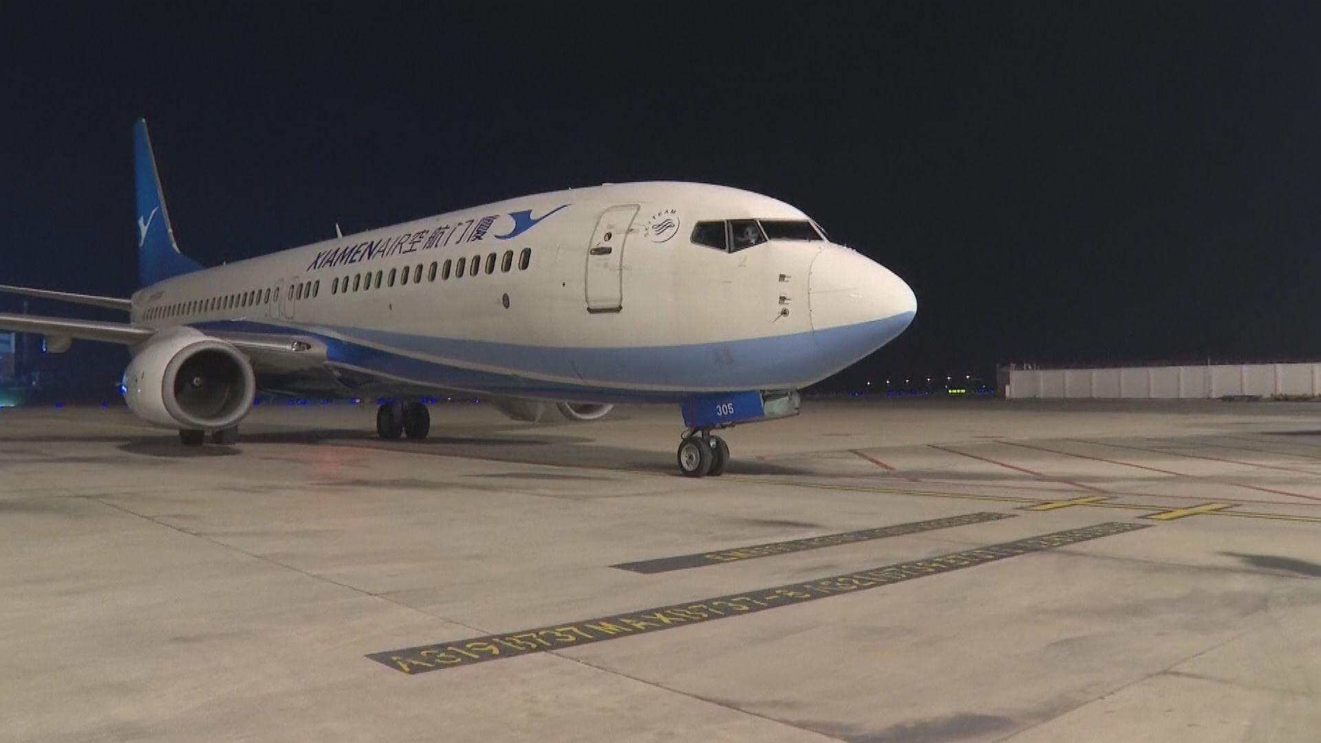 中國首班接載滯留海外旅客包機返抵武漢