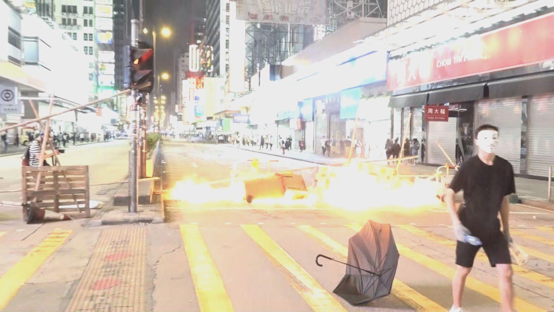 人民日報評論批公務員參與違法暴力衝擊