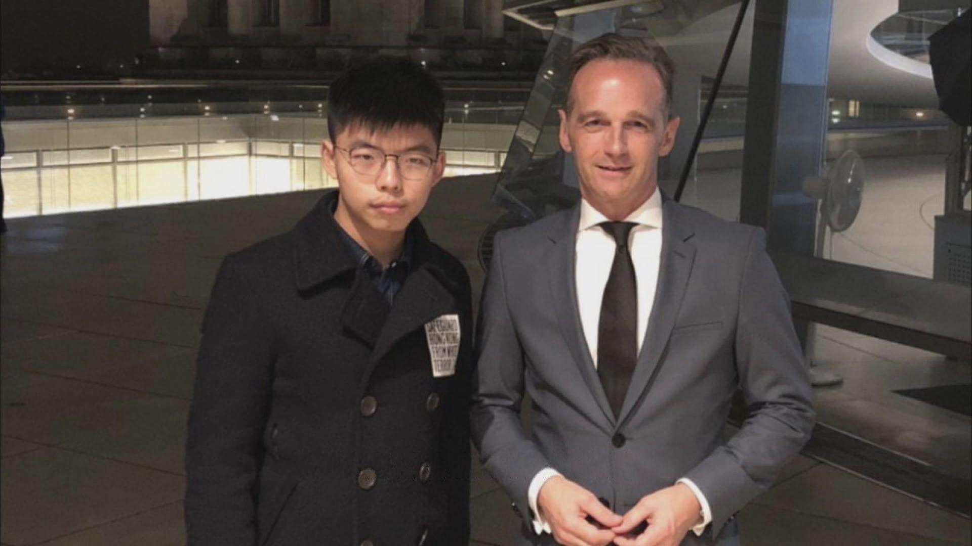 黃之鋒赴德與外交部長馬斯講述香港情況